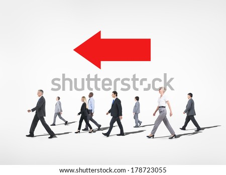 Group of Diverse Business People Walking in Direction of an Arrow - stock photo