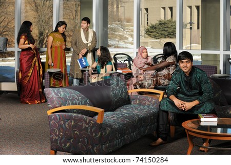 Group of Diverse College Students wearing their traditional attire in the University Campus - stock photo
