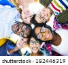 Group of Diverse Colorful Friends With Their Heads Together - stock photo