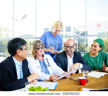 Group of Diverse Doctors In Meeting at Hospital - stock photo