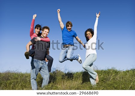 Group of diverse friends on a sunny day - stock photo