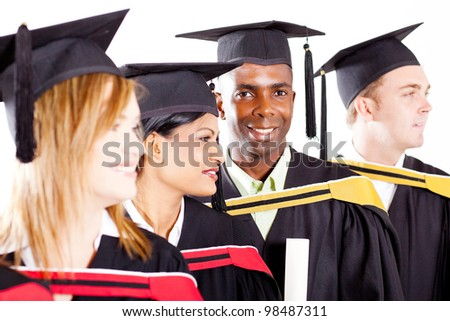 group of diverse graduates at graduation - stock photo