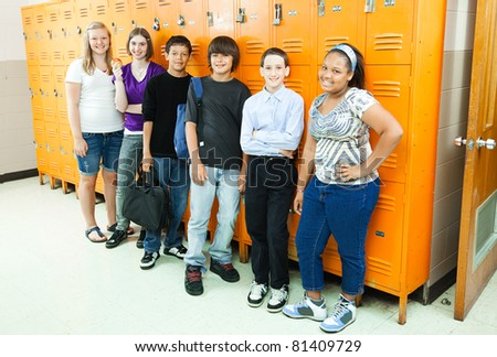 Group of diverse high school students by the school lockers. - stock photo