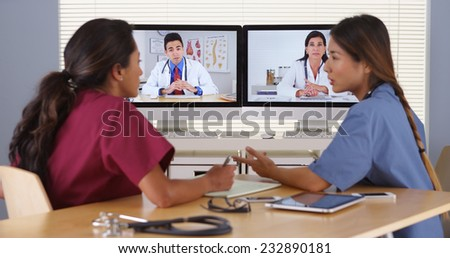 Group of diverse medical doctors video conferencing - stock photo
