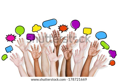 Group of Diverse Multi Ethnic Hands Reaching for Speech Bubbles - stock photo