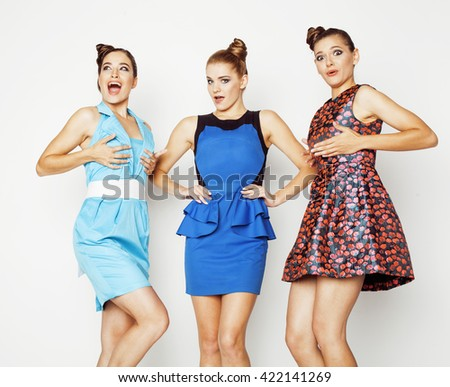 group of diverse stylish ladies in bright dresses isolated on white smiling having fun, watching selfie, posing cheerful, lifestyle concept - stock photo