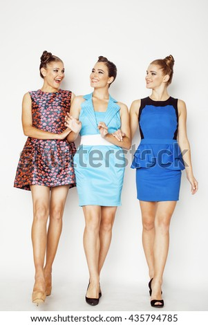group of diverse stylish ladies in bright dresses isolated on white smiling having fun, watching selfie - stock photo