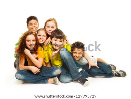 Group of diversity looking kids, boys and girls sitting on the floor, in white background - stock photo
