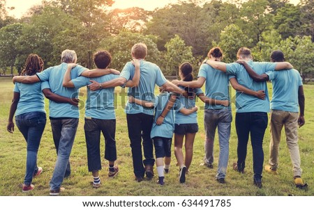 Group of diversity people volunteer arm around