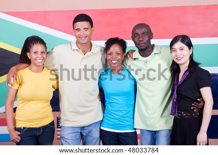 group of diversity young adults in front of South African flag, 2010 South Africa world cup concept