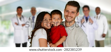 Group of doctors and a family set in a hospital - stock photo