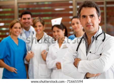 Group of doctors and nurses at the hospital smiling - stock photo