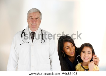 Group of doctors and nurses working with a patient - stock photo