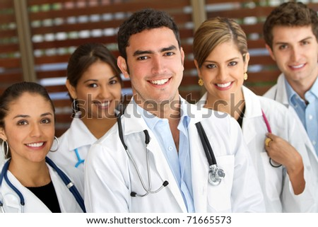 Group of doctors at the hospital and smiling - stock photo
