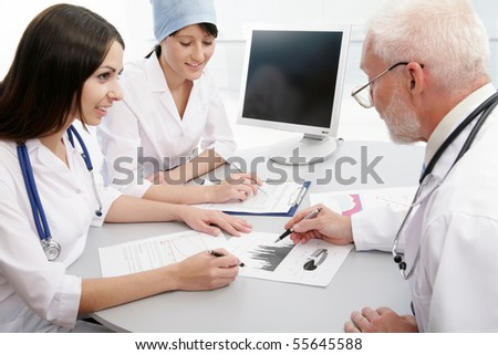 Group of doctors discuss work - stock photo