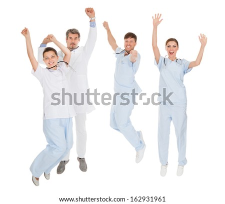 Group Of Doctors Expressing Joy With Raising Hands Over White Background - stock photo