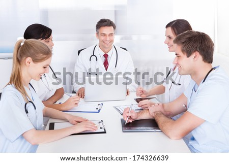 Group Of Doctors Having Meeting In A Hospital - stock photo