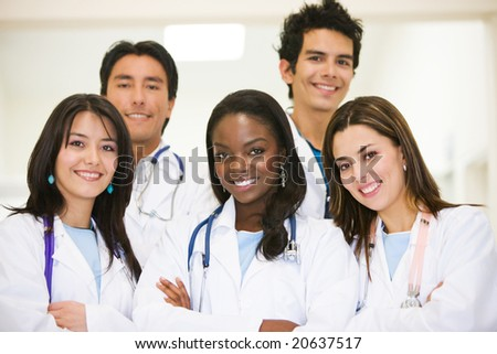 group of doctors standing and smiling in a hospital