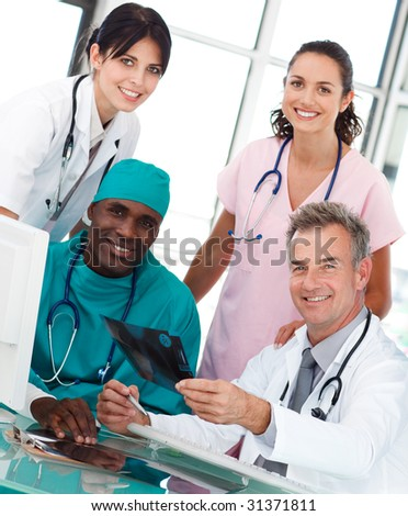 Group of doctors talking in an office about an X-ray