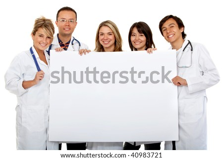 Group of doctors with a banner isolated over a white background - stock photo