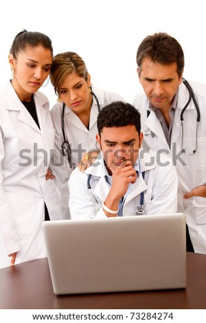 Group of doctors with a computer - isolated over white