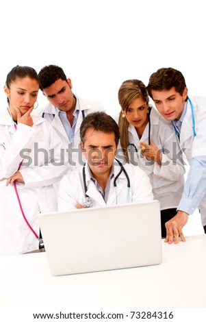 Group of doctors with a computer - isolated over white - stock photo