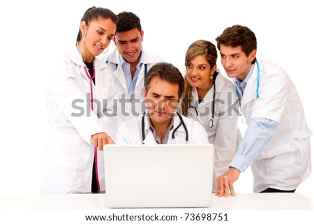 Group of doctors with a laptop isolated over a white background