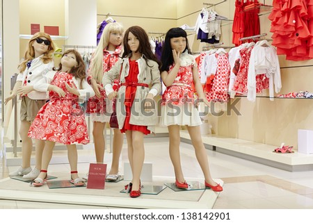 Group of dressed female mannequins in clothing store - stock photo