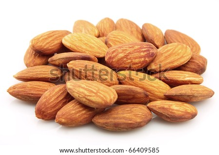 Group of dries almonds on a white background - stock photo