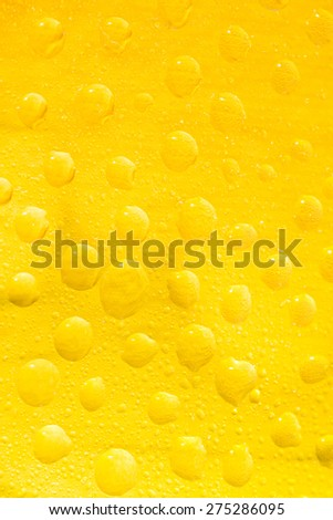 Group of drops portrait on yellow background