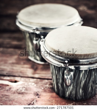 group of  drums on dark wooden background/ selective focus - stock photo