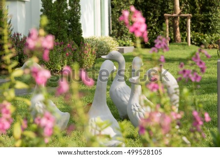 Group of duck statue decorated in the garden.