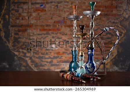 group of eastern hookahs on table - stock photo