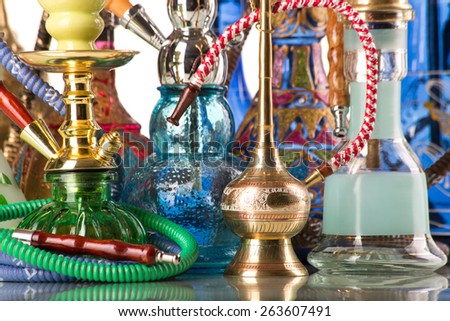 Group of eastern hookahs on white background