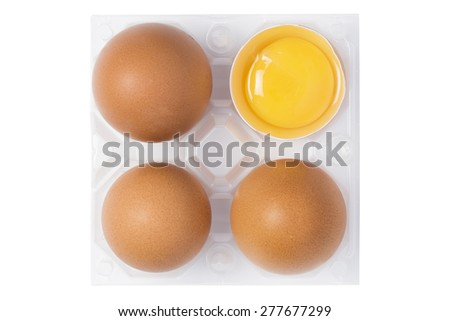 group of eggs with one opened with yolk  in plastic basket on white background - stock photo
