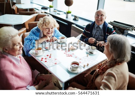 Group of elderly people sitting by table  talking and playing lotto. Elderly Stock Images  Royalty Free Images   Vectors   Shutterstock
