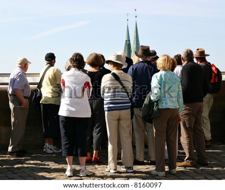 Group of elderly tourists on a sightseeing tour in Germany - stock photo