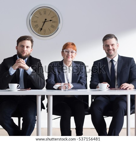 Group of elegant businessman having a meeting about jobinterview