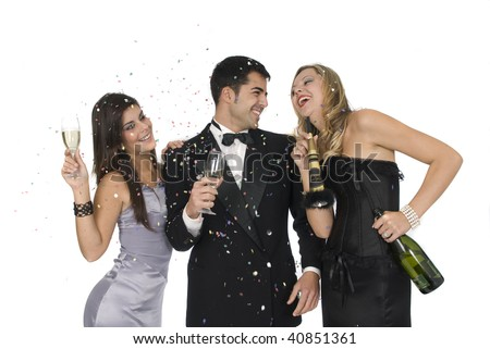 group of elegants friends at a new year party laughing