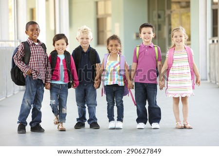 Group Of Elementary Age Schoolchildren Standing Outside - stock photo