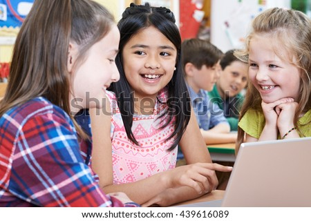 Group Of Elementary School Children Working Together In Computer Class - stock photo