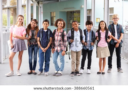 Group of elementary school kids hanging out at school - stock photo