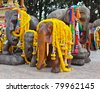 Group of elephant statues decorated with flowers - stock photo