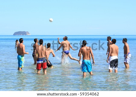 Group of eleven handsome guys playing - stock photo