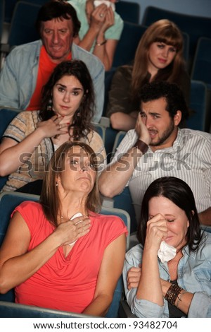 Group of 7 emotional male and female spectators weep - stock photo