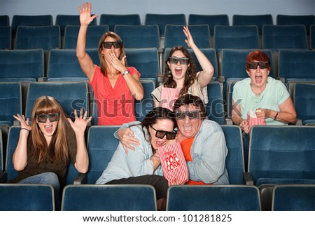 Group of emotional people with 3D glasses in a theater - stock photo