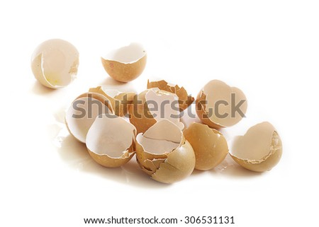 Group of empty broken eggshells isolated on a white background with copy space, selected focus - stock photo