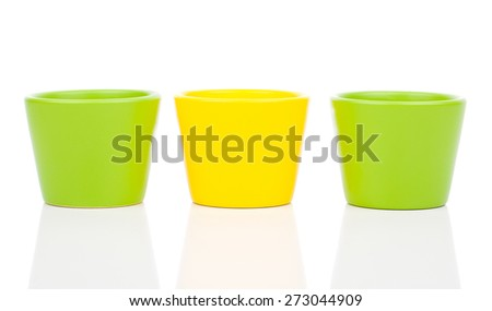 group of empty ceramic flower pots, isolated on white background - stock photo