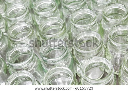 group of empty glass jar in factory - stock photo