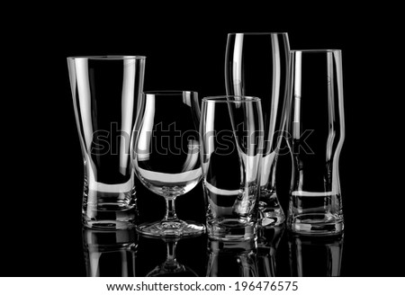 Group of empty glasses different sizes  - stock photo